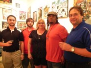 Craig & Gina Borel, with their sons,. They purchased a commission piece.