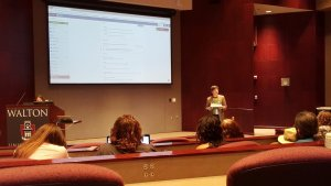 Ben Pollock, at right, steps a volunteer from the audience (at lectern) in creating a WordPress.com website June 23 at the 2018 WordCamp Fayetteville.
