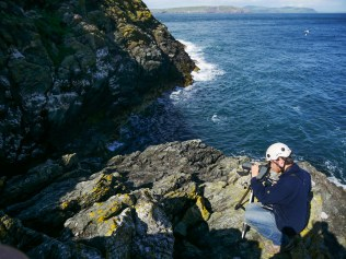 Liam counting Guillemot and Kittiwake nests