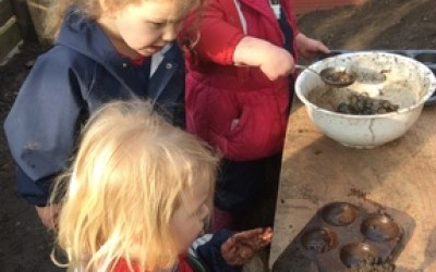 Exploring in our new mud kitchen!
