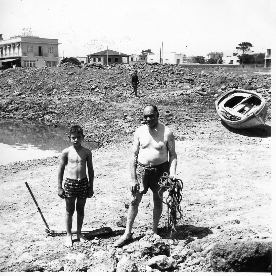 Byron & father Emmanuel at the NEB grounds during construction days ca. 1959.