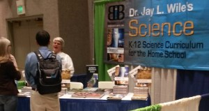 Couple talking to author at a homeschool convention