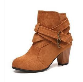 Woman ankle boots heeled with belt and buckle Low-top.