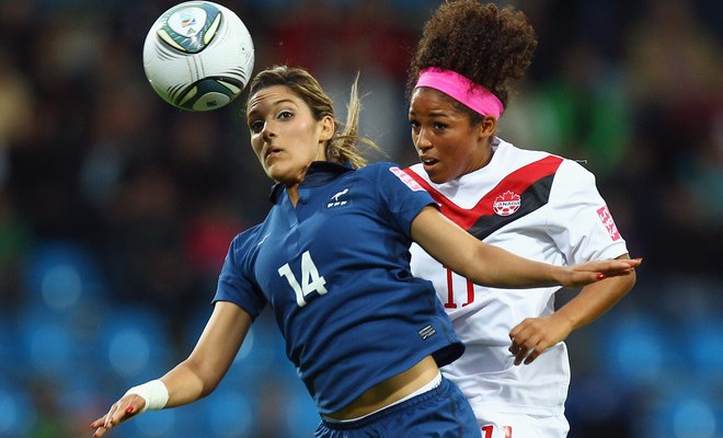 BOCHUM, GERMANY - JUNE 30: Louisa Necib (L) of France jumps for a header with Desiree Scott of Canada during the FIFA Women's World Cup 2011 Group A match between Canada and France at the Fifa Womens World Cup Stadium on June 30, 2011 in Bochum, Germany.  (Photo by Alex Grimm/Bongarts/Getty Images)
