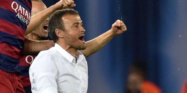 Barcelona's coach Luis Enrique (C) celebrates after winning the UEFA Super Cup final football match between FC Barcelona and Sevilla FC on August 11, 2015 at the Boris Paichadze Dinamo Arena in Tbilisi. AFP PHOTO / KIRILL KUDRYAVTSEV