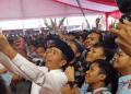 Presiden Joko Widodo (Jokowi) saat menghadiri perayaan Milad 1 Abad Madrasah Mu'allimin–Mu'allimaat Muhammadiyah di Yogyakarta, Senin (6/12/2018).