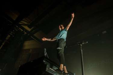 Andrew standing on his piano keys