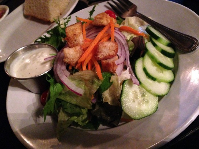 Cosa offers the standard house salad with mixed greens, cucumbers, carrots, onions, cherry tomatoes and croutons.