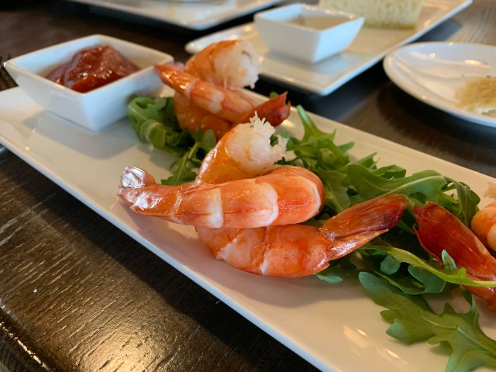 The beautifully presented shrimp cocktail with six interlocked pieces of shrimp.