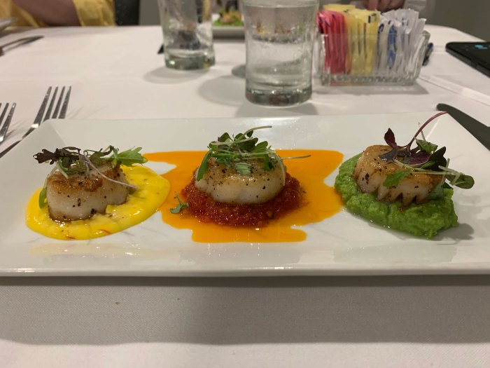 Pan-seared scallops with yellow, red and green sauces