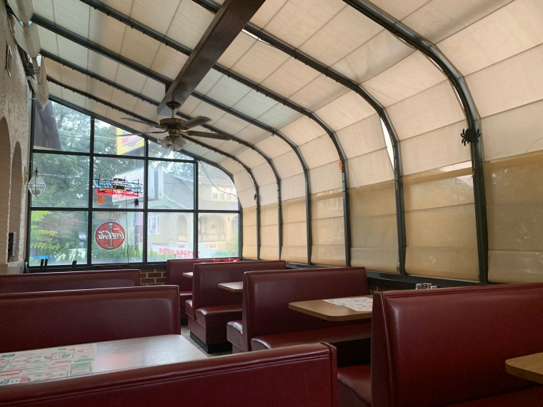 Booths line the sunroom at Pizza Como in Hamburg