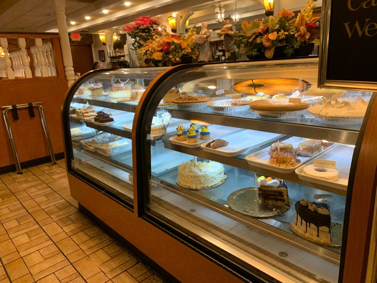 Assorted cakes and pies in the display case at the Pied Piper Diner