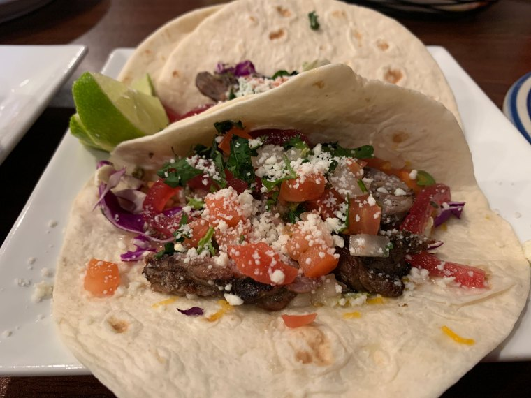 Three soft-shell tacos with steak, pico de gallo, cabbage and pickled red onion from Norte Sur.