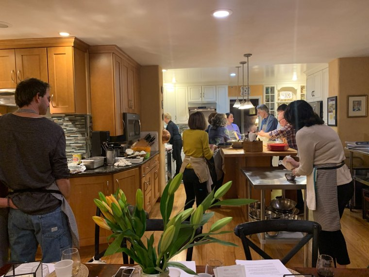 Teams of people working in a kitchen