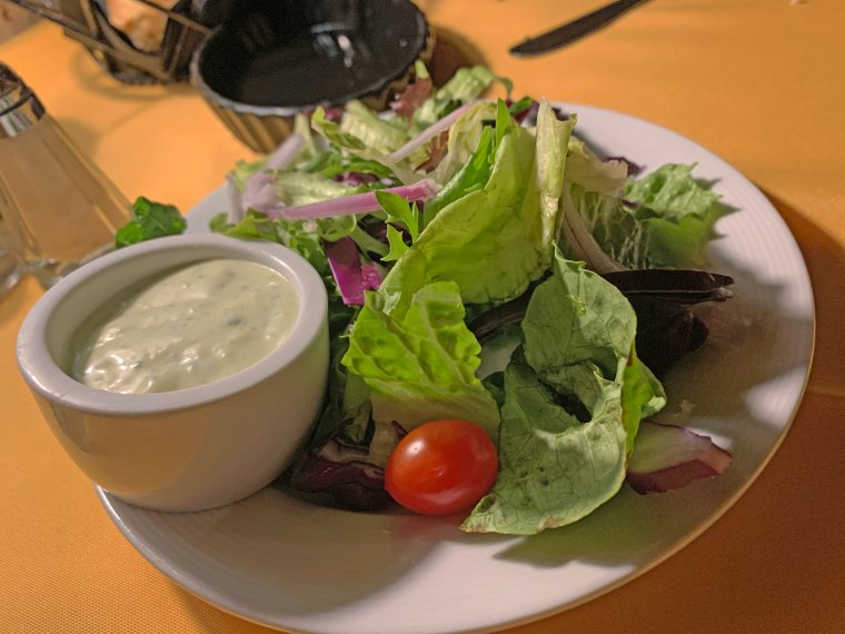 Mixed green salad with a cup of ranch dressing from Judy's on Cherry