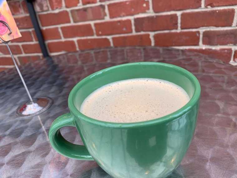 A green mug filled with chai tea latte from the Greenhouse Cafe