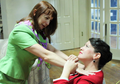 (l-r) Natalie Wilder (Muriel) and Sophia L. Garder (Pamela) have a polite disagreement.