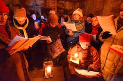An intimate carol sing by candlelight in Williamstown.