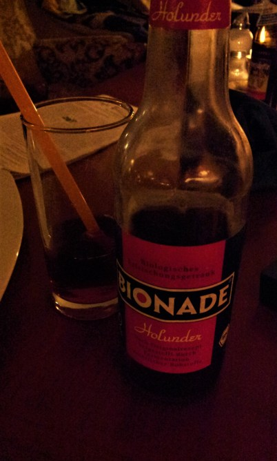 An organic lemonade with elderberry flavor, called Bionade, which is quite popular in Germany and Austria