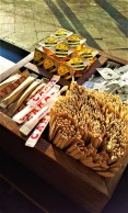 The goodies for your coffee, some sugar, sticks, and honey