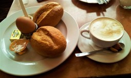 My breakfast consists of two rolls, two pieces of butter, marmalade, honey, and a hard-boiled egg....I added a cappuccino to my breakfast