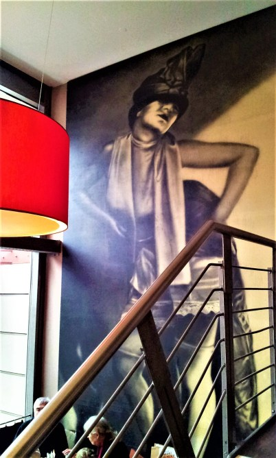 The art on the wall is quite posing and imposing in its size at the same time