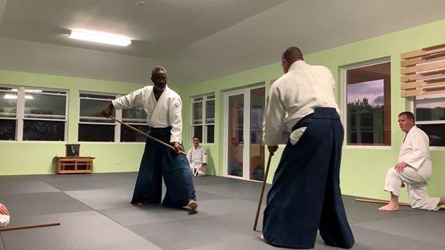 Sensei Smith demonstrates jo techniques, with Eugene during Wednesday night weapons at Bermuda Aikikai.