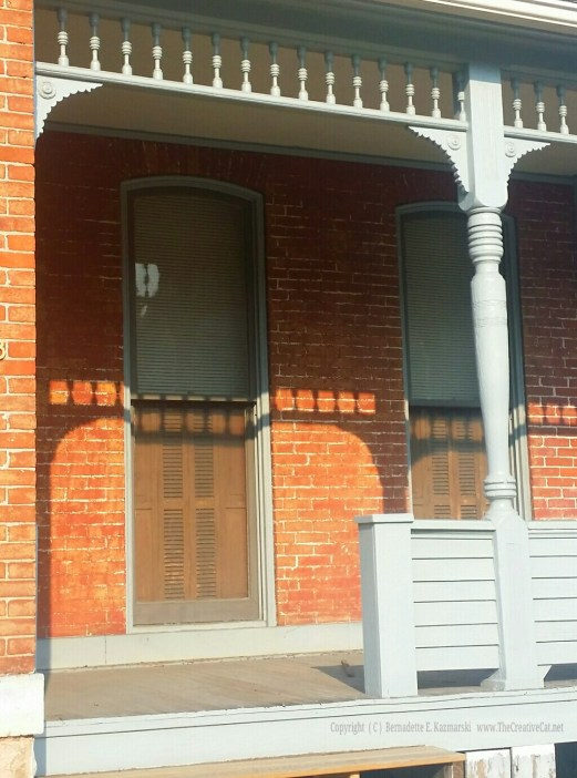 I've always loved this duplex on Washington Avenue with the full-length windows and custom shutters.