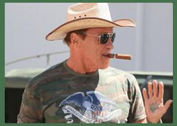 30fa6ba8a14 Arnold Schwarzenegger wears a cowboy hat
