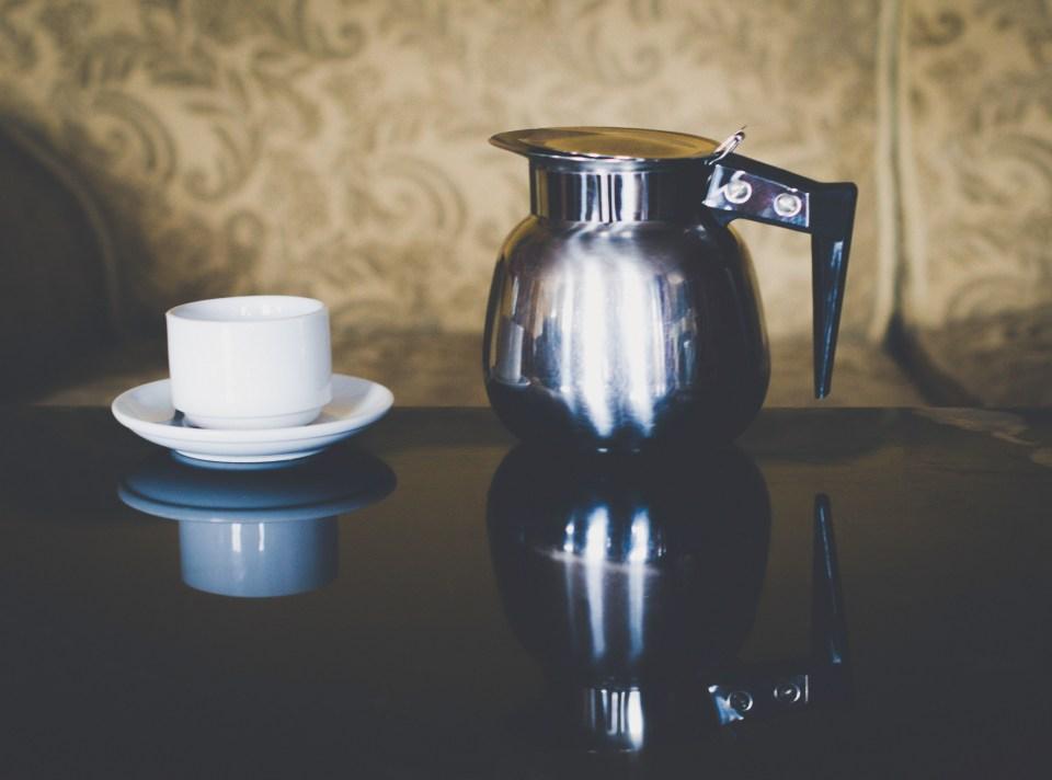 Coffee jug and coffee mug, before coffee is poured. by Bernie Delaney.