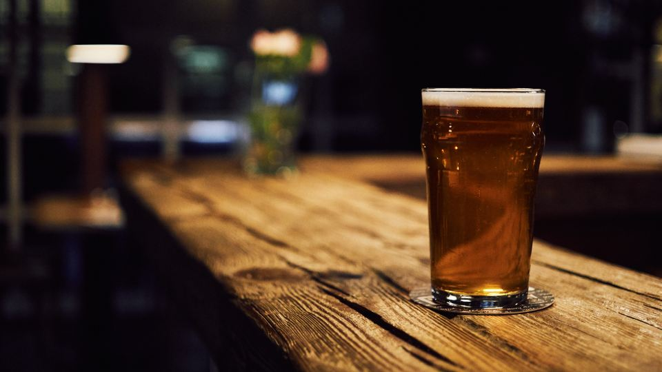 A pint of beer on the counter of Knockmeaden bar where this Drama excerpt is set.