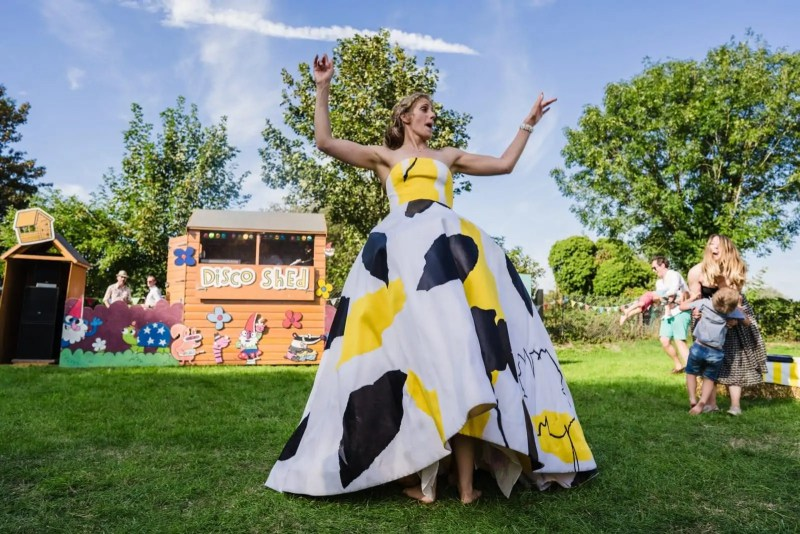bride in a yellow and black wedding dress in a field