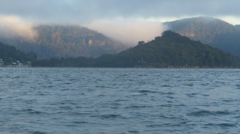 Milson's Island, escarpments behind lit up by the dawn