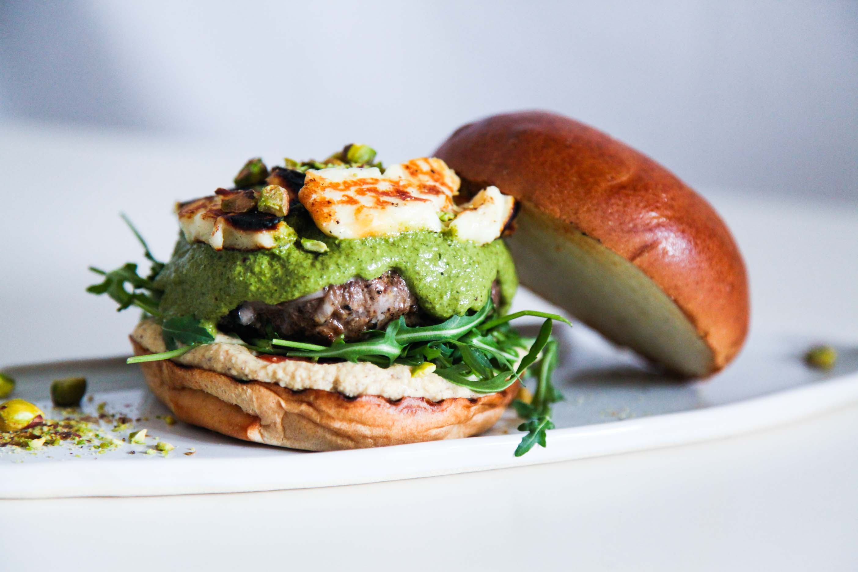 Super Tasty Lamb Burger With Halloumi And Green Herb Sauce Berries And Spice