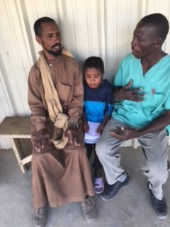 Nomad father and son with Pastor Bernard