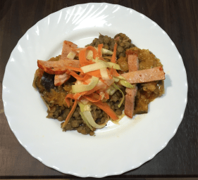 Pork loin over lentils with capenada (eggplant, peppers, tomato and onions)