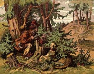 Jäger liegt auf der Lauer