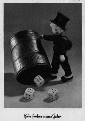 Figur: Schornsteinfeger als Glücksbringer mit Würfelbecher