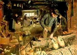 Ölgemälde: Holzschuhmacher-Werkstatt in der einige Männer und Frauen arbeiten