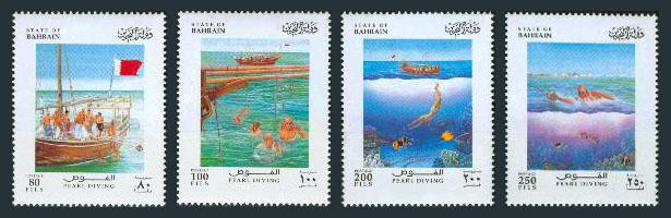 vier Briefmarken mit Szenen vom Perlentauchen