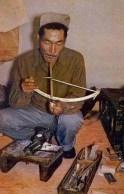 Elfenbeinschnitzer: Inuit mit Munddrill