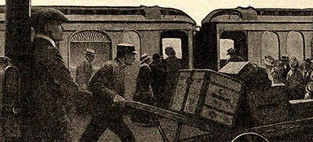 sw-Zeitungsbild: Gepäckmann mit Gepäckkarre am Bahnsteig