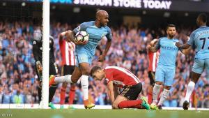 Manchester City's English midfielder Fabian Delph (CL) collects the ball after Sunderland's Northern Irish defender Paddy McNair (CR floor) scored an own goal during the English Premier League football match between Manchester City and Sunderland at the Etihad Stadium in Manchester, north west England, on August 13, 2016. / AFP / PAUL ELLIS / RESTRICTED TO EDITORIAL USE. No use with unauthorized audio, video, data, fixture lists, club/league logos or 'live' services. Online in-match use limited to 75 images, no video emulation. No use in betting, games or single club/league/player publications.  /         (Photo credit should read PAUL ELLIS/AFP/Getty Images)