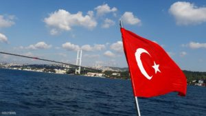 A Turkish flag is pictured on a boat with the Bosphorus bridge in the background in Istanbul, Turkey, August 6, 2016. REUTERS/Osman Orsal