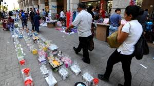 Tunisians walk past displays of wares set up by street vendors on the first day of the Muslim holy fasting month of Ramadan at a central market in Tunis on August 1, 2011. Throughout the month of Ramadan devout Muslims must abstain from food, drink and sex from dawn until sunset when they break the fast with the Iftar meal. AFP PHOTO / FETHI BELAID (Photo credit should read FETHI BELAID/AFP/Getty Images)