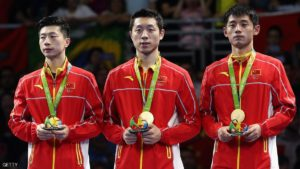 RIO DE JANEIRO, BRAZIL - AUGUST 17:  Gold medalists Long Ma, Xin Xu, and Jike Zhang of China celebrate during the medals ceremony after the Men's Table Tennis gold medal match against Japan at Riocentro - Pavilion 3 on Day 12 of the Rio 2016 Olympic Games  on August 17, 2016 in Rio de Janeiro, Brazil.  (Photo by Phil Walter/Getty Images)