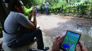 People use tablets and smartphones to play the newly launched Pokemon Go game at a public park in Mexico City on August 10, 2016.  / AFP / ALFREDO ESTRELLA        (Photo credit should read ALFREDO ESTRELLA/AFP/Getty Images)