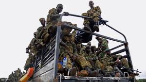 Uganda military personnel are seen atop military and police trucks driving towards Juba, South Sudan, at Nimule border point on July 14, 2016.  The Ugandan Army have started an evacuation mission to extract 3000 ugandan civilians stranded by the recent fighting between army loyal to President Salvar Kiir and first Vice-president Riek Machar.   / AFP / ISAAC KASAMANI        (Photo credit should read ISAAC KASAMANI/AFP/Getty Images)