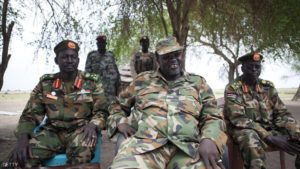 South Sudanese rebel leader and former vice president Riek Machar (C) sits in an army barracks in South Sudan's Upper Nile State on April 14, 2014. Conflict in South Sudan has triggered a serious risk of famine that will kill up to 50,000 children within months if immediate action is not taken, the UN has warned. The African country has experienced high levels of malnutrition since it gained independence in 2011, UNICEF said, and conditions have worsened since ethnic conflict broke out between troops loyal to President Salva Kiir and supporters of his former deputy Riek Machar. AFP PHOTO / ZACHARIAS ABUBEKER        (Photo credit should read ZACHARIAS ABUBEKER/AFP/Getty Images)