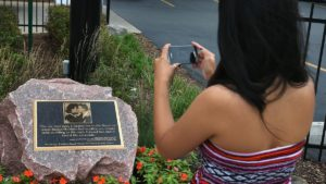 CHICAGO, IL - AUGUST 16: Imee Estiller takes a picture of a plaque placed outside a strip mall in the Hyde Park neighborhood marks the location where President Barack Obama and first lady Michelle Obama shared their first kiss on August 16, 2012 in Chicago, Illinois. The kiss took place in 1989 on the corner of Dorchester and 53rd Streets when the president treated the first lady to ice cream at a Baskin-Robbins in the mall, which is now a Subway restaurant. The Obamas will celebrate their 20th wedding anniversary in October. (Photo by Scott Olson/Getty Images)
